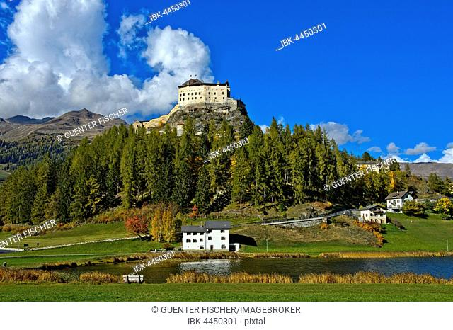 Tarasp Castle above the Lai da Tarasp, Scuol, Lower Engadine, Grisons, Switzerland