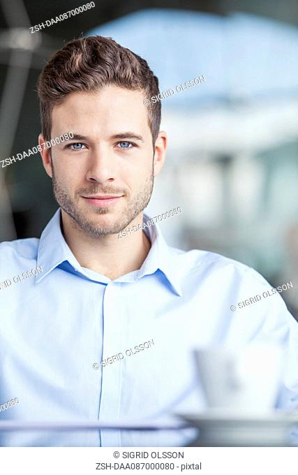Businessman taking coffee break