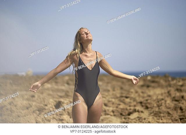 Woman at beach. Malia, Crete, Greece