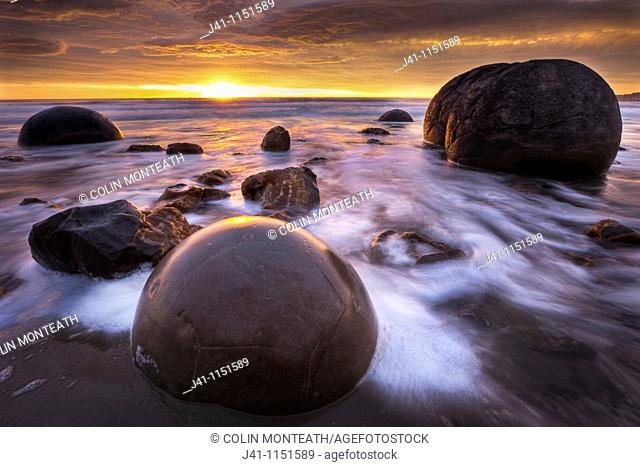 Moeraki boulders at dawn as SW front passes overhead, near Oamaru, Otago