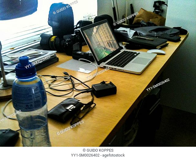 Berlin, Germany. Mobile & Temporary Workplace of a Photo Journalist at a Colleagues Plattenbau Apartment, eastern part of town