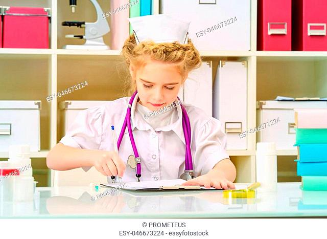 Pretty little girl playing a doctor at home. Different occupations. Children's Health, Pediatrics
