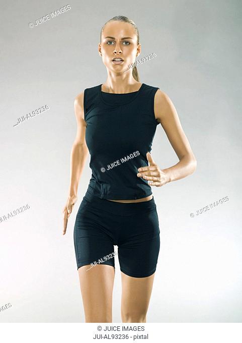 Studio shot of female runner