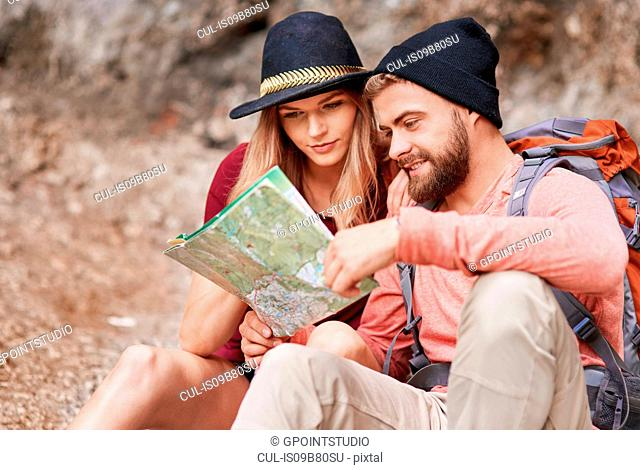 Couple looking at map, Krakow, Malopolskie, Poland, Europe