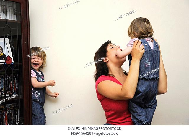 Mother and twin girls at home