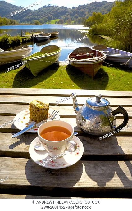 The Lake District. Afternoon Tea in front of beached boats. Grasmere, Lake District National Park, Cumbria, England, United Kingdom