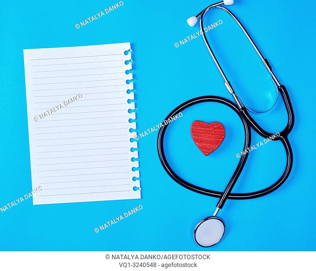 blank white piece of paper in a line and a medical stethoscope on a blue background