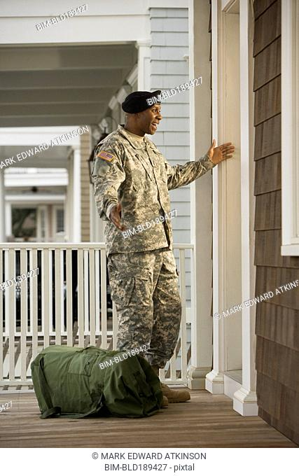 African soldier returning home