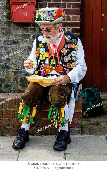 A Morris Dancer Enjoys A Fish and Chip Lunch At The Lewes Folk Festival 2016, Lewes, Sussex, UK