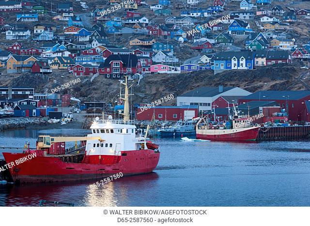 Greenland, Qaqortoq, elevated view of town and harbor, dusk