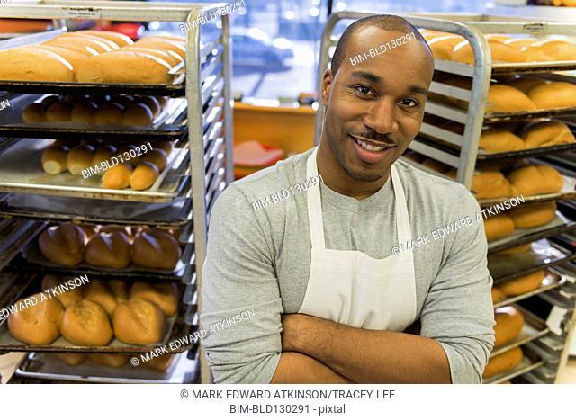 Black baker working in commercial kitchen