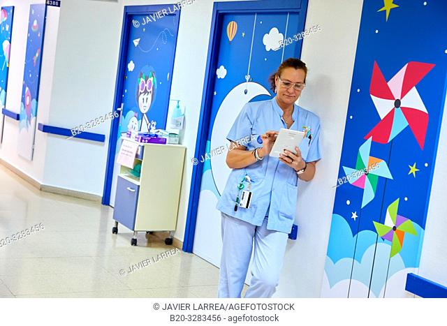 Nurse with tablet, Plant for hospitalization of children, Pediatrics, Medical care, Hospital Donostia, San Sebastian, Gipuzkoa, Basque Country, Spain