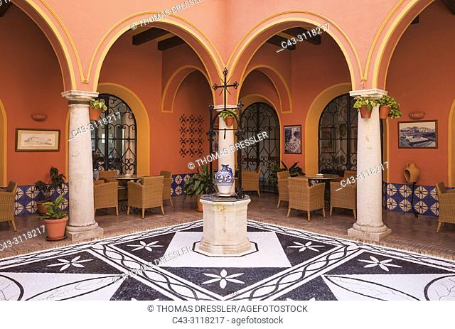 The patio of the Parador (luxury state-run hotel) in the hilltop White Town of Arcos de la Frontera. Cadiz province, Andalusia, Spain