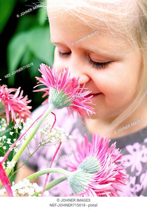 Scandinavian girl with pink flowers, Sweden