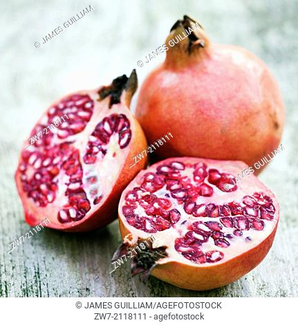 Fruit, Pomegranate halved showing interior flesh and seeds
