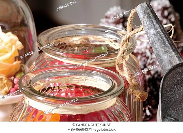 Sweets in glass tins, close-up