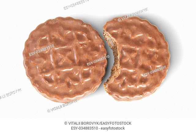 Whole And Bitten Off Chocolate Cookies Lying Next Isolated On White Background
