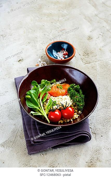 A rainbow Buddha bowl with quinoa, smoked salmon, ricotta and vegetables