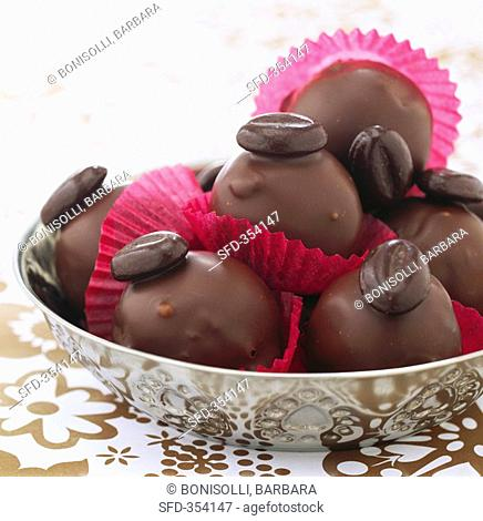 Chocolate-coated marzipan balls with nuts