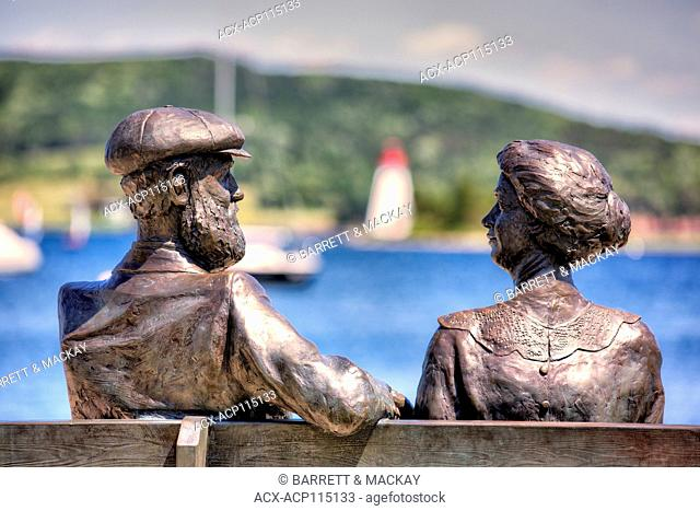 Bronzed statue of Alexander Graham Bell and his wife, Baddeck waterfront, Cape Breton, Nova Scotia