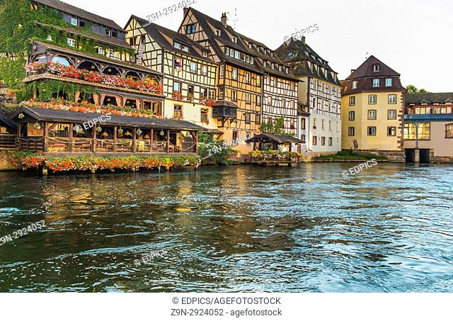 traditional half-timbered houses on the banks of river ill at dusk, petite france district, strasbourg, alsace, Bas-Rhin, France