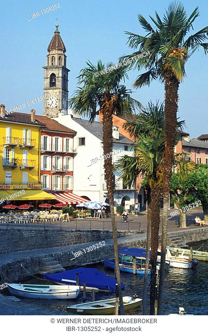 View of the waterfront of Ascona, boardwalk, cafes, restaurants, fishing port, fishing boats, Lake Maggiore, Ticino, Switzerland, Europe
