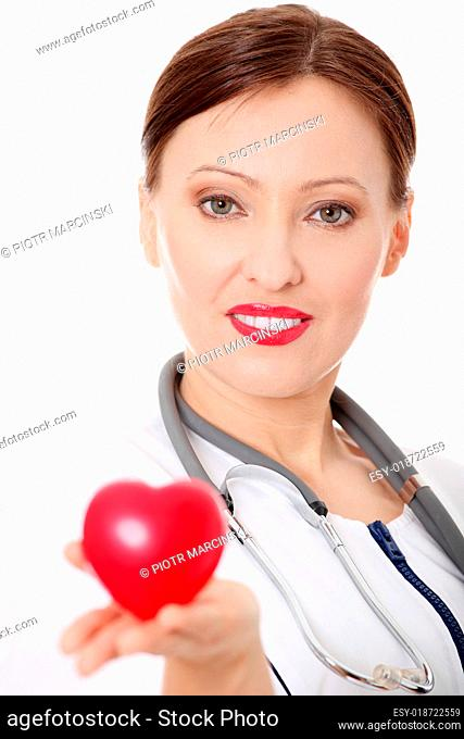 Mature female doctor with heart in her hand
