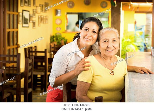 Smiling women at counter in restaurant
