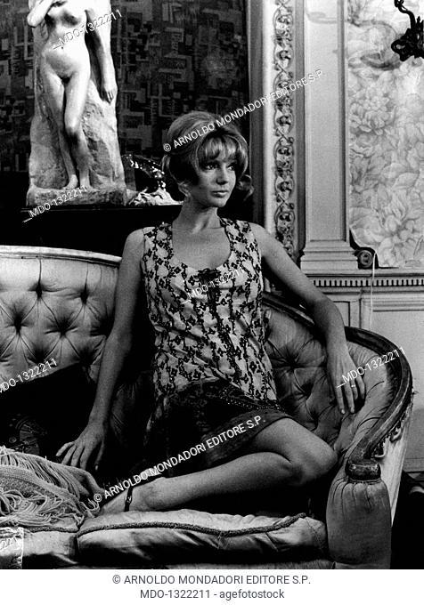 Sylva Koscina in Paris. Croatian-born Italian actress Sylva Koscina posing sitting on a coach. Paris, 1970