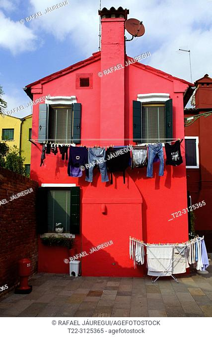 Burano (Italy). Colorful facade on the island of Burano from the lagoon of Venice