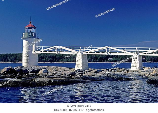 MARSHALL POINT LIGHTHOUSE 1858 with white plank boardwalk serves the fishing village of PORT CLYDE - MAINE, USA