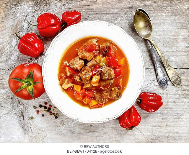 Top view of tomato soup with fresh vegetables and meat