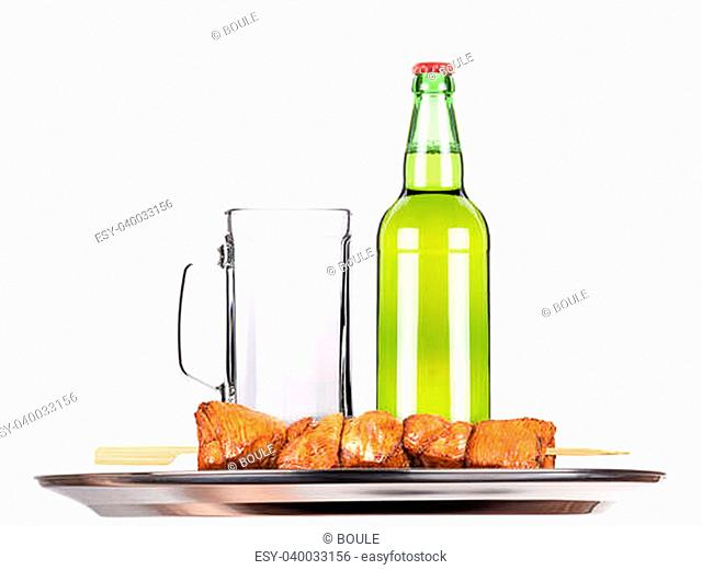 fresh grilled meat dishes with beer glass isolated on a tray