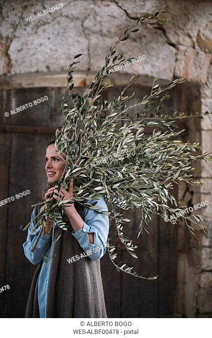 Woman carrying twigs