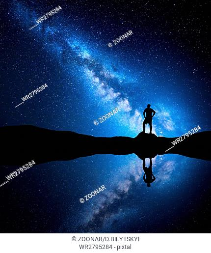Milky Way and silhouette of a standing alone man