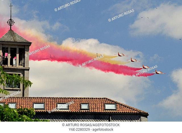 Air Force jets with contrails colors of spanish flag over San Lorenzo de El Escorial (Madrid), Spain