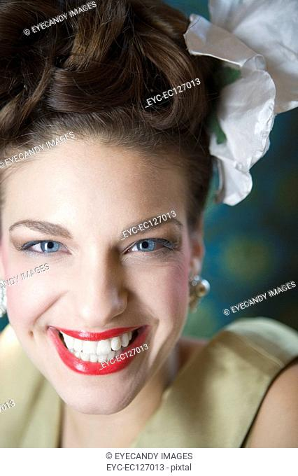 Close-up of happy stylish woman wearing evening wear, looking at camera