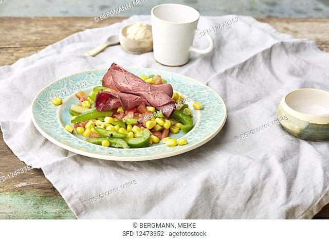 Roast beef with a pepper and sweetcorn salad