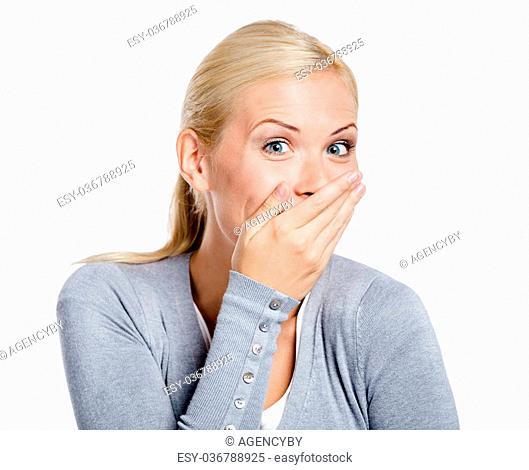 Laughing woman in gray sweater covers mouth with hand, isolated on white