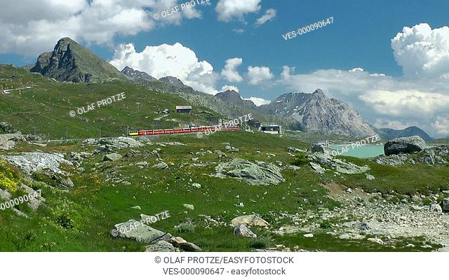 Alpine train passing Lago Bianco, Switzerland, Schweiz