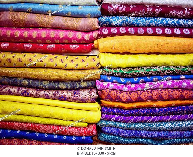 Close up of piles of multicolor fabrics