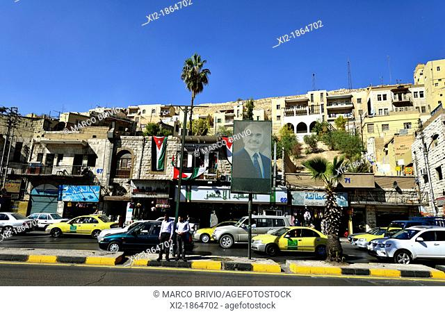 A busy street of Amman, Jordan with the photo of King Hussein