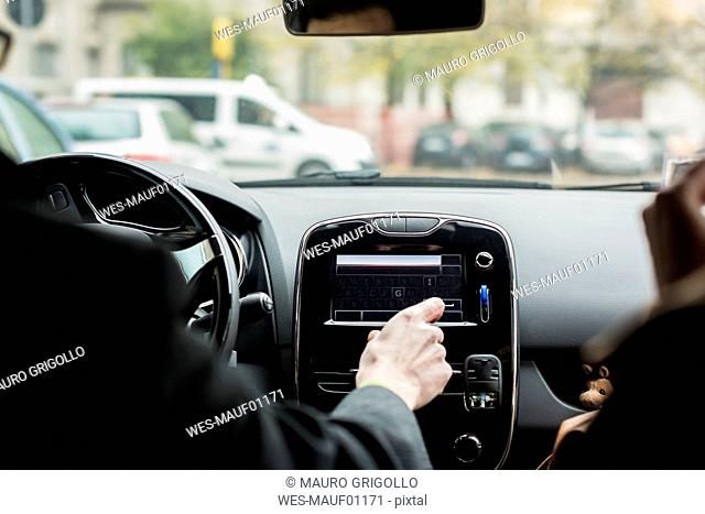 Close-up of businessman using navigation device in car