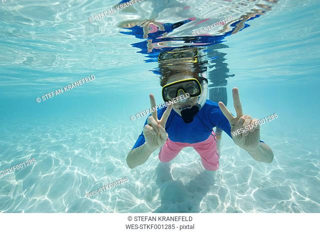Maldives, happy woman snorkeling in the Indian Ocean