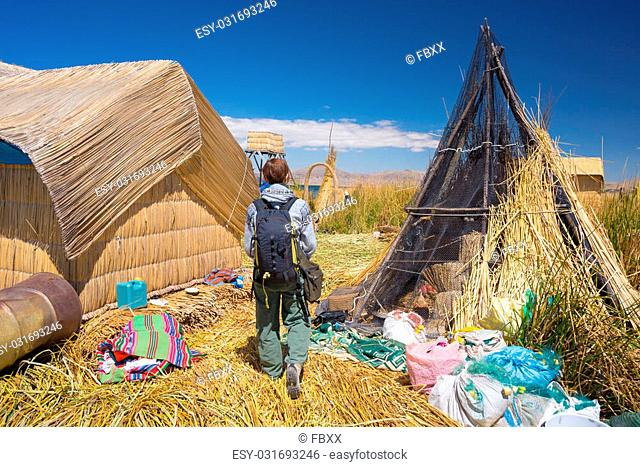 Tourist roaming in a village of the Uros Islands, entirely made of Totora Reeds, floating on Titicaca Lake, among the most interesting travel destination in...