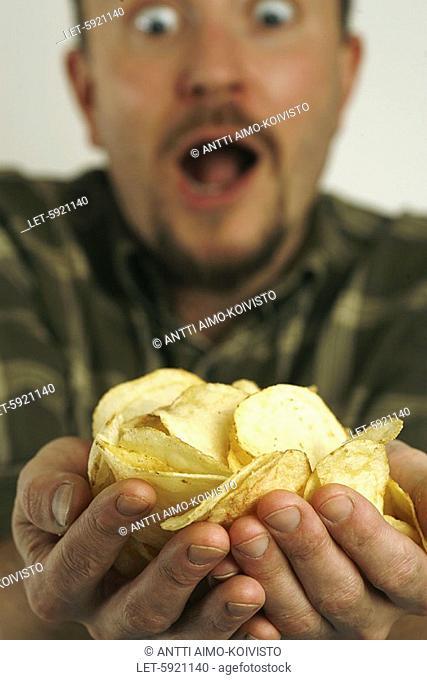 Man binging crisps