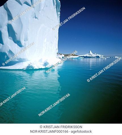 Greenland - Iceberg floating on water