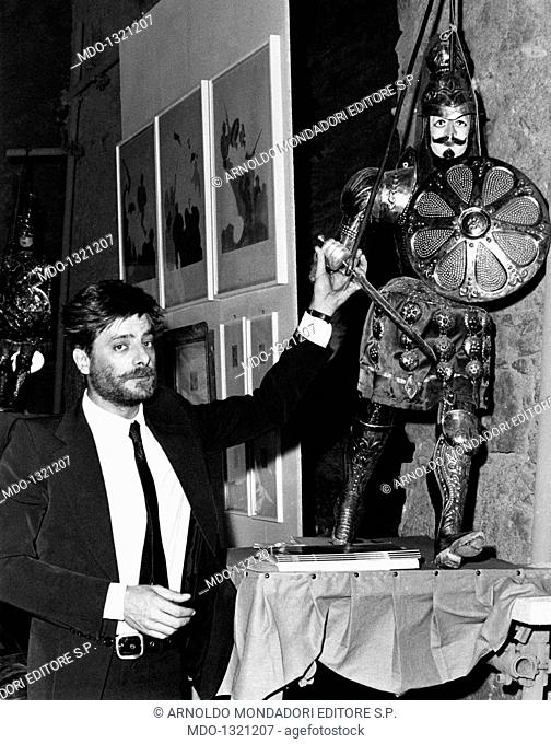 Giancarlo Giannini showing a Sicilian string puppet. The Italian actor and voice actor Giancarlo Giannini showing a Sicilian string puppet
