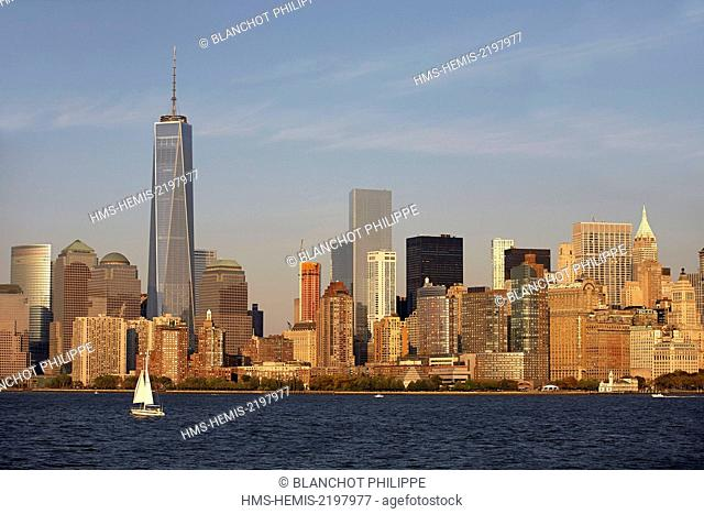 United States, New York, Manhattan, View of Lower Manhattan and the new One World Trade Center from Ellis Island at sunset
