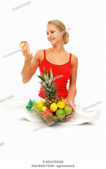 young, sporty woman with fruits